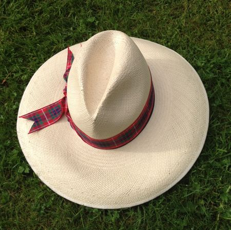 big straw hat on grass