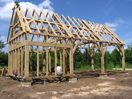 a timber frame against blue sky