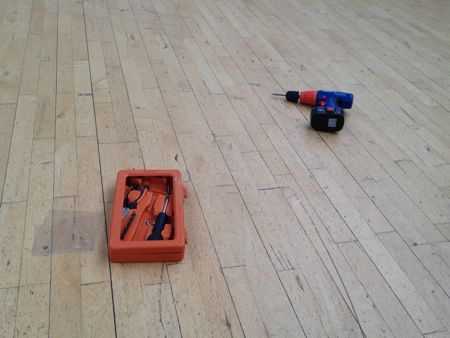 electric drill on bare floor