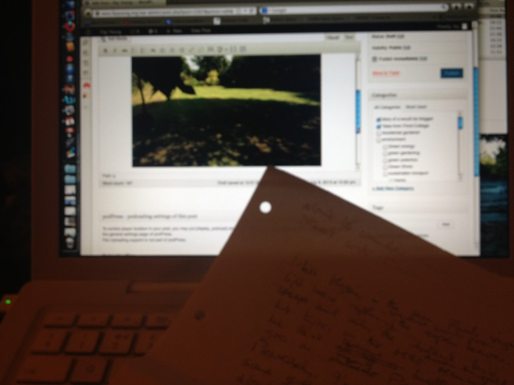 Handwritten notes in front of the computer screen