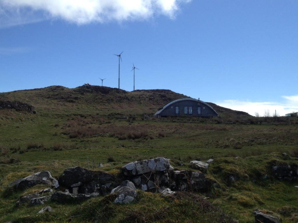 Wind turbines on the hill above Muck's community centre