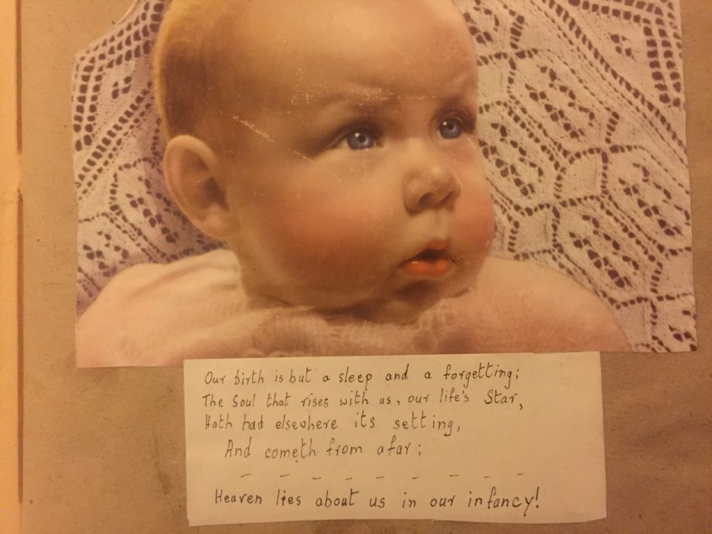 A rosy cheeked baby with lines of Wordsworth, 'Heaven lies about us in our infancy'.